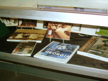 A view of the glass case of display books