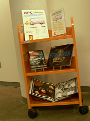 A book cart with display books