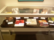 books in the case for the genocide display