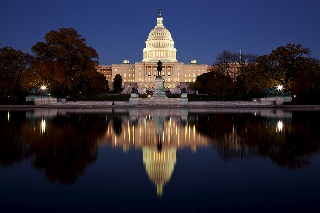 A photograph of the Capitol Building at night