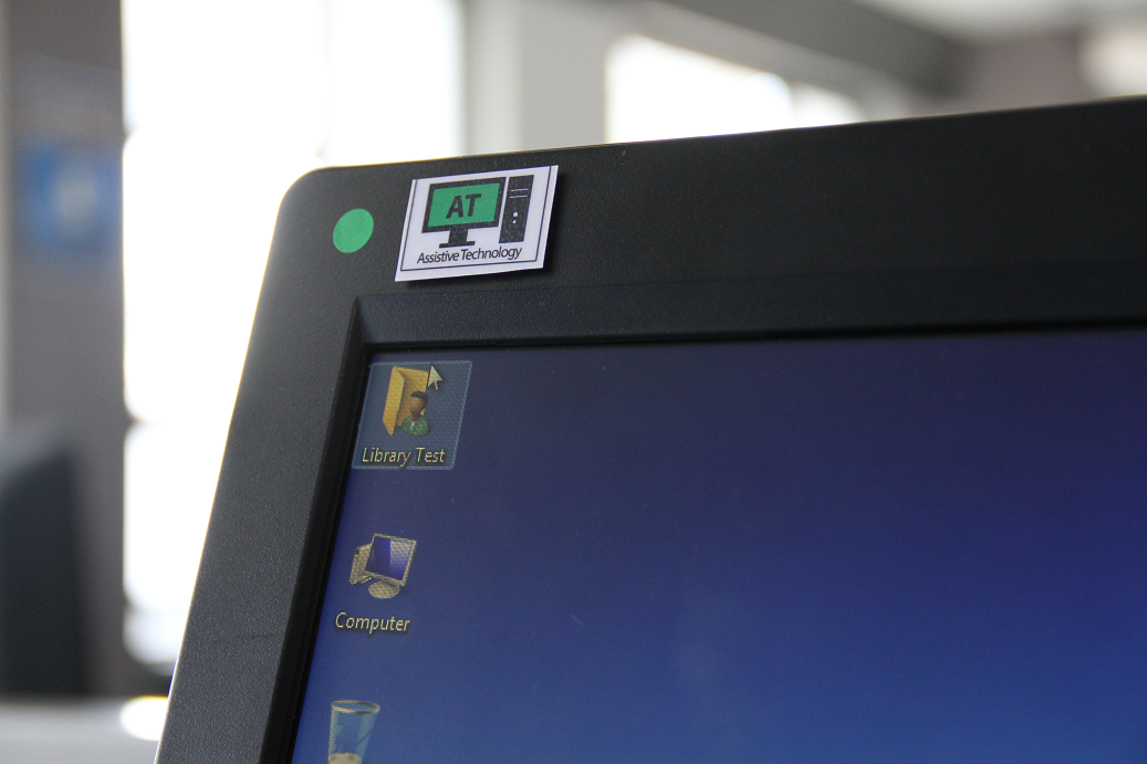 a picture of an AT sticker that indicates a computer has assistive software installed on it.