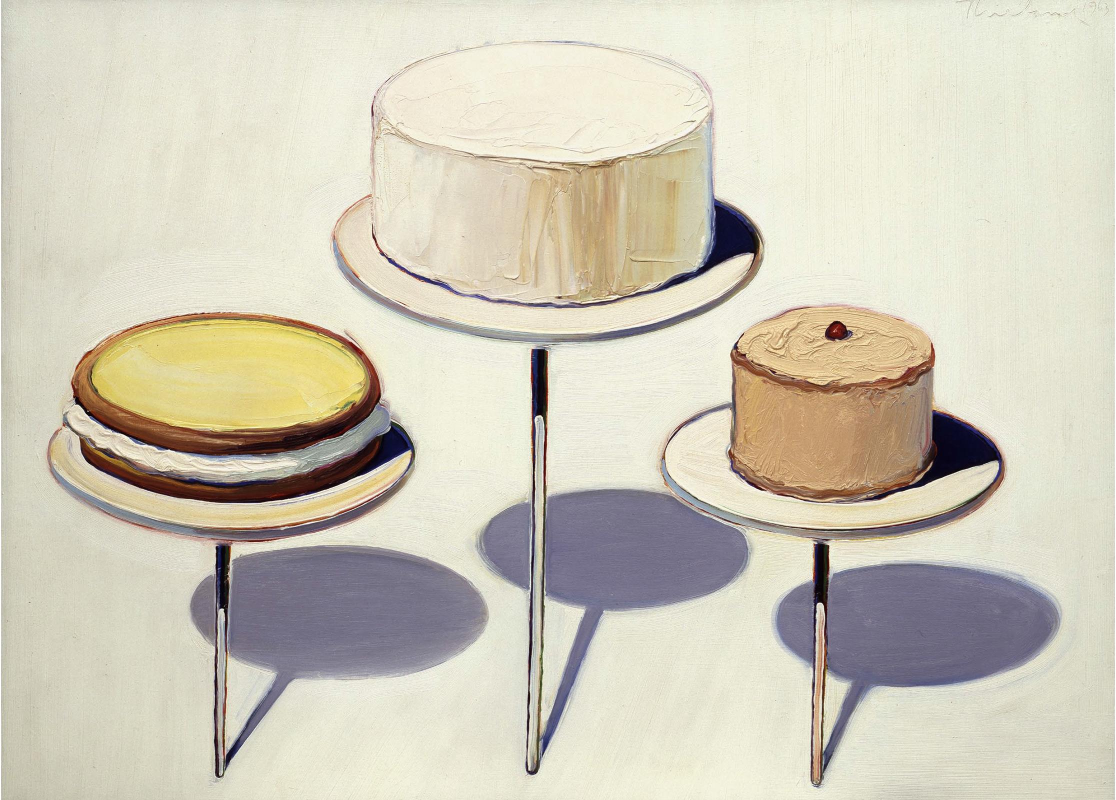 three painted cakes