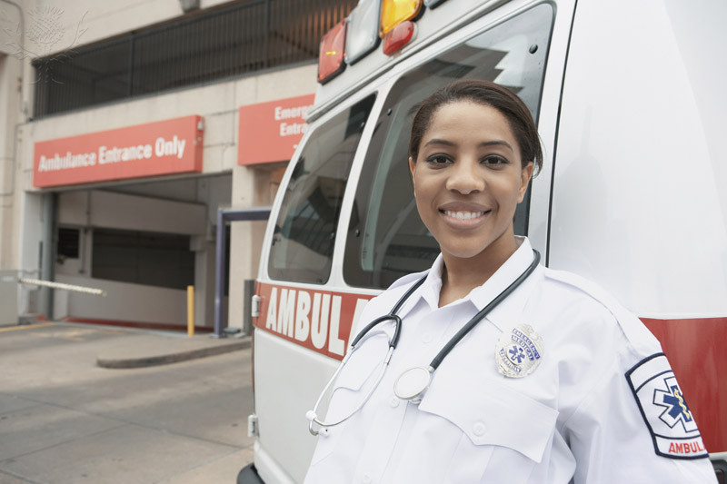 female EMT standing near ambulance