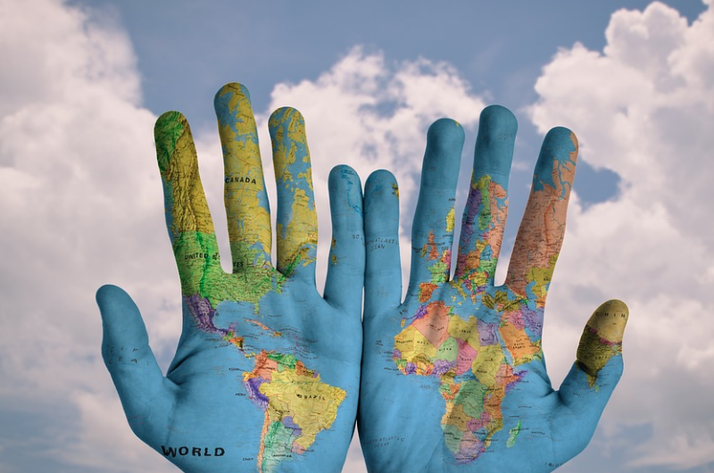 Photo of a map of the world painted on hands