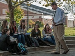 Faculty teaching students outside
