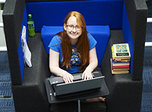 Student sitting in a laptop chair