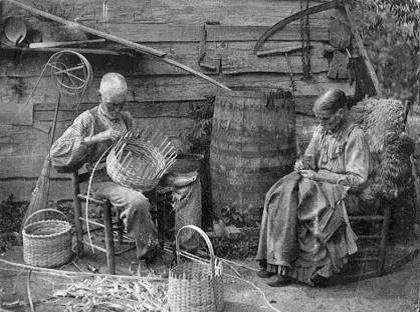 Sally Ann Powell Burnell, and her brother Sammy Powell making baskets - photo by Coleman Ogg