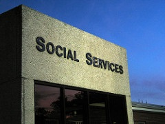 picture of building with sign saying social services