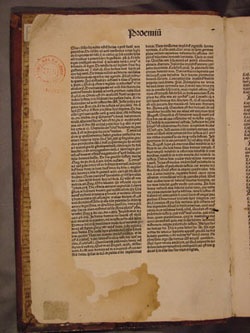 Jesuit book stamp from Louvain in Antoninus, SUMMA THEOLOGICA (1490)