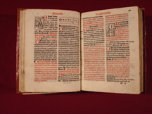fols. 25v-26, with two liturgical vignettes