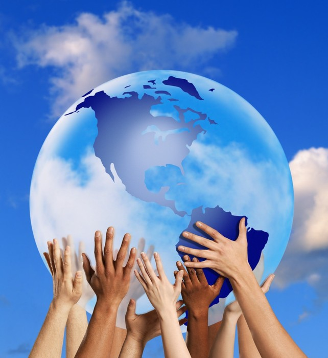 Picture of several hands holding up a globe together