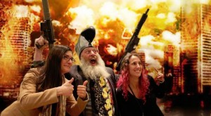 Vermin Supreme files for the Presidential Election with machine guns, flowers and girls on his arms.