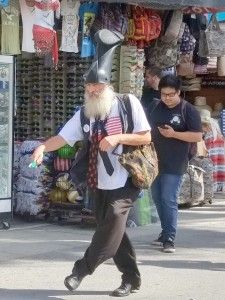Vermin Supreme doing a funny walk on Venice Boardwalk