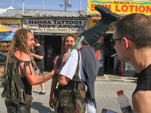 Vermin Supreme talks to some well tanned free people on Muscle Beach