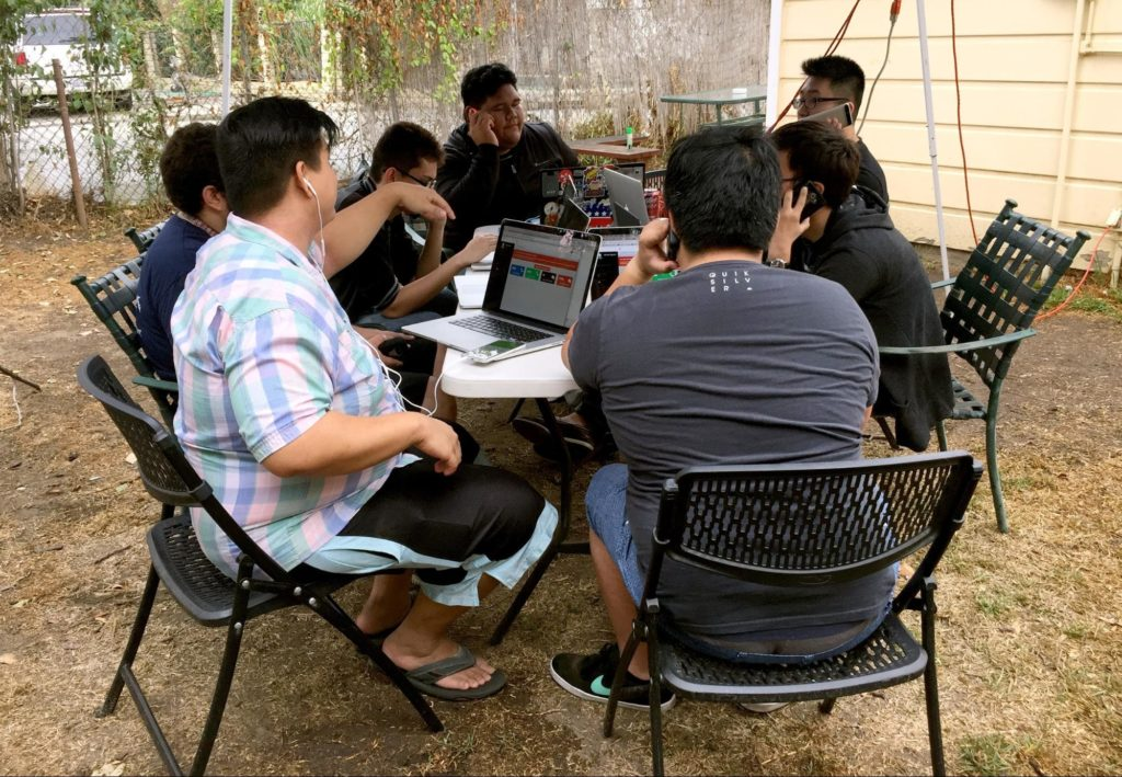 Phone banking was easy to get people into when they were encouraged to get together. This phone bank party overflowed into the back yard where extensions cords powered laptops used for managing phone calls.