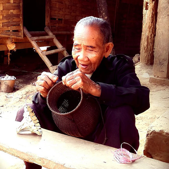 106-year old Khmu making fish trap, Laos