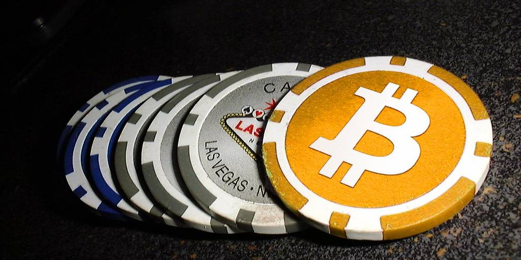 Poker chips with Bitcoin logo