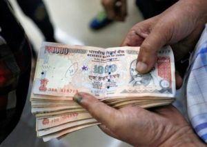"1,000 rupee banknotes – worth 700 rupees each today, available from the newest entrants into the money-changer business. Unfortunately, their business model is fraudulent; it sure seems a strange way to ""fight corruption"". Photo credit: Reuters"