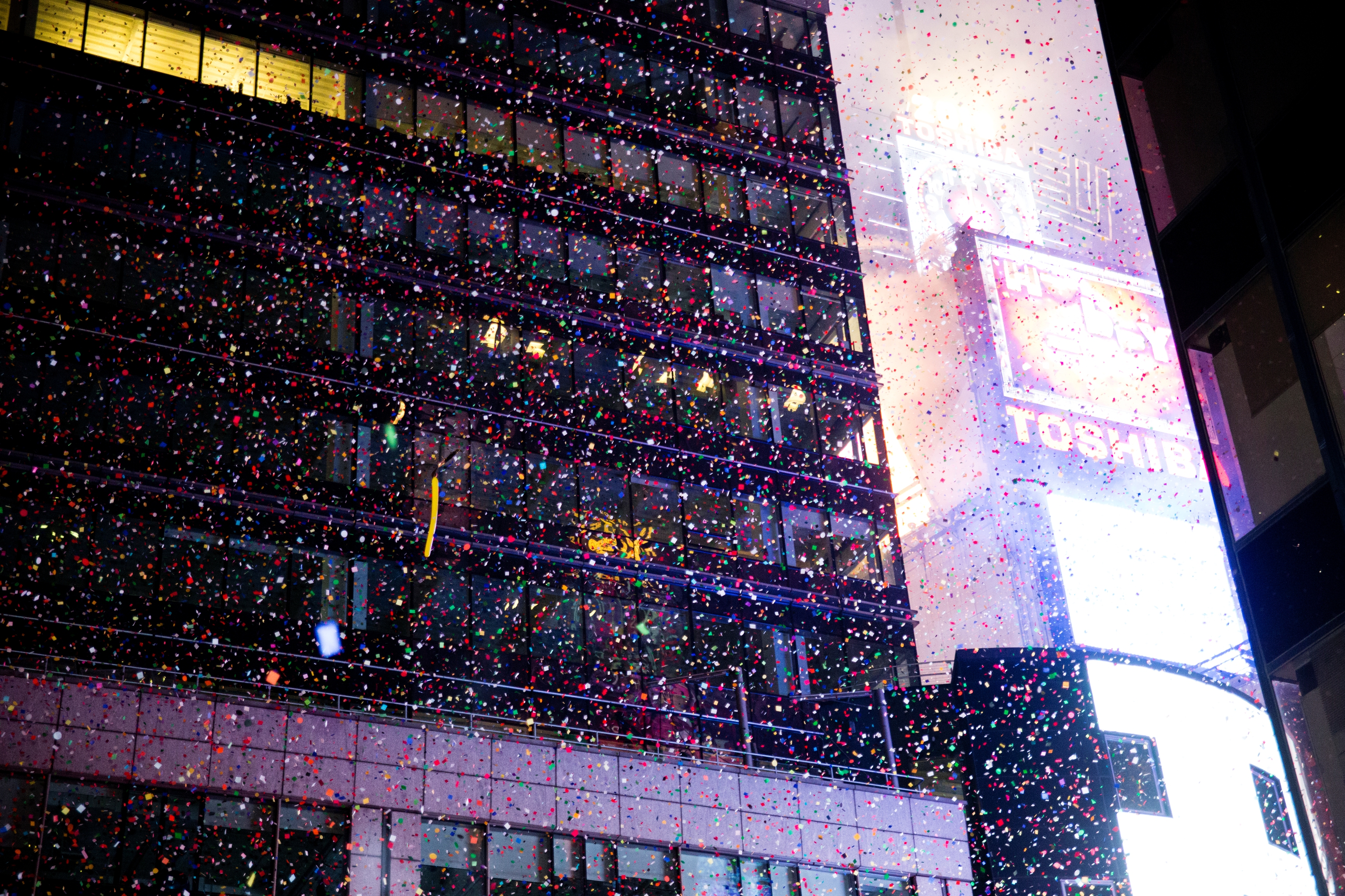 Confetti falling over Times Square on New Years Eve