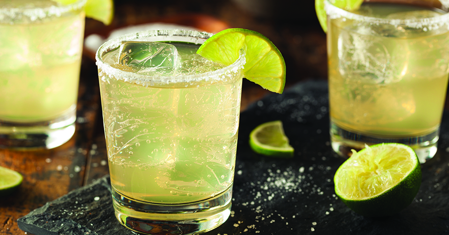 Margarita cocktail with lime and salt on the rim