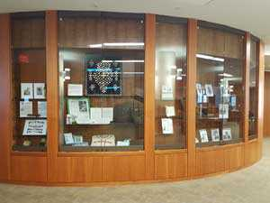 glass display cases with photos and artifacts inside