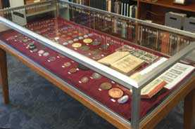 Photo of the display case containing The Numismatic Luther: The Frederick J. and Joyce Schumacher Collection