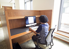 Student working at a computer workstation