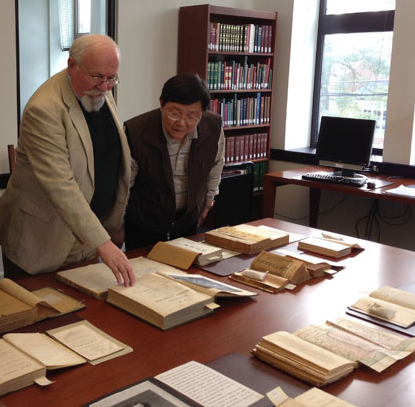 Kenneth W. Henke, Curator of Special Collections and Archivist at Princeton Theological Seminary, shows visiting researchers some items from Special Collections, 2015