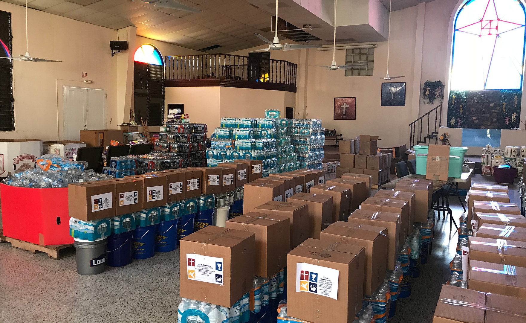 Cases of water purification filters in a church, waiting to be distributed.