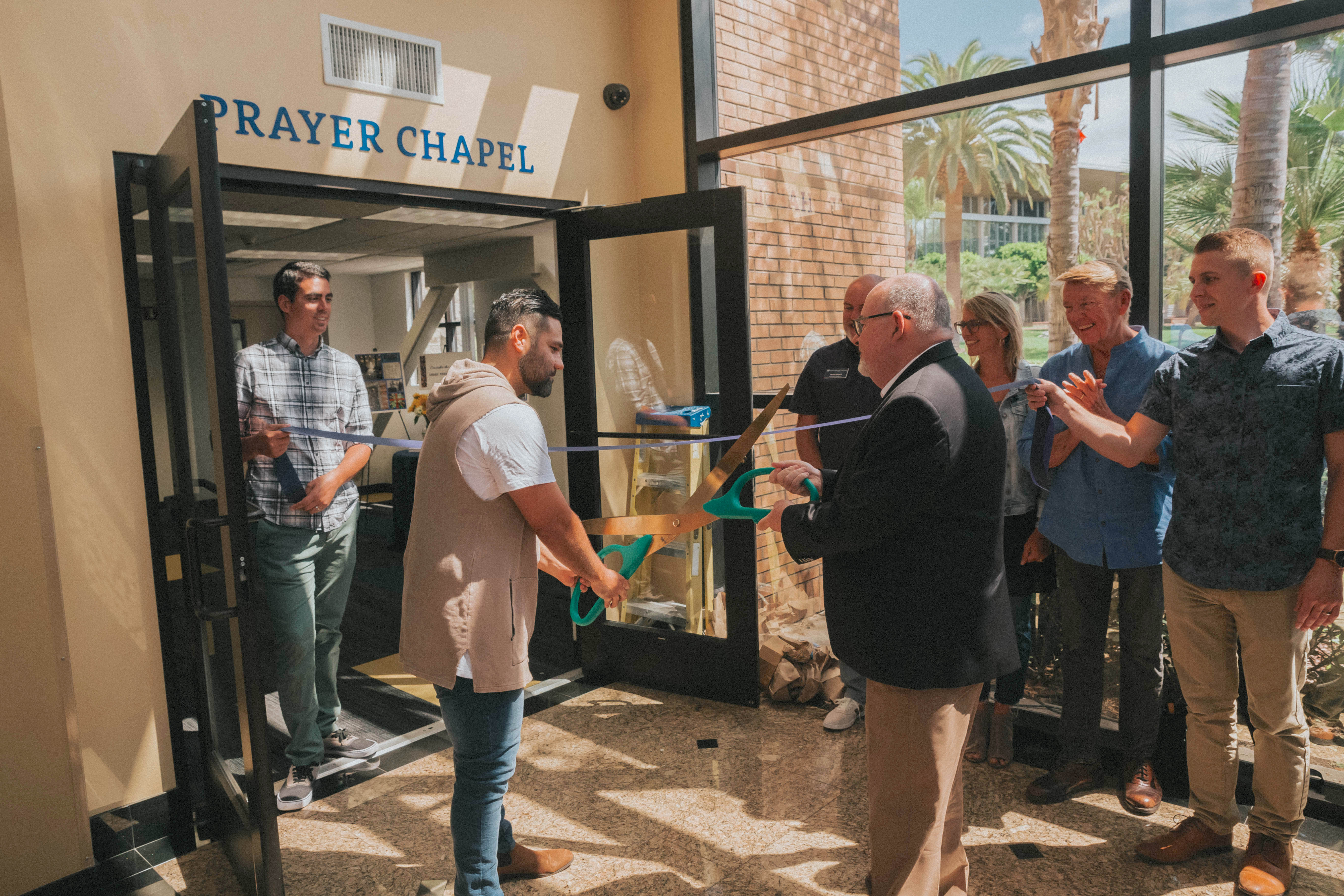 President Jim Adams and Campus Chaplain Phil Urdiales cutting the ribbon for the grand opening of Life Pacific's prayer chapel.