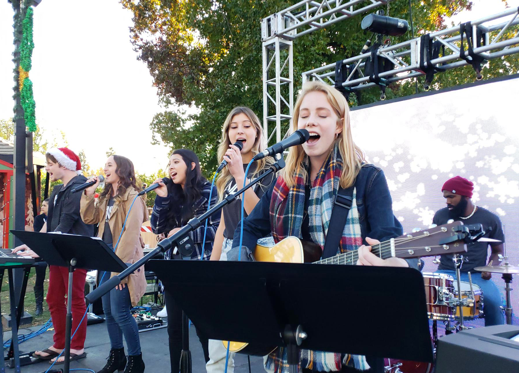 Photo of LPC students singing on stage during San Dimas Holiday Extravaganza Parade.