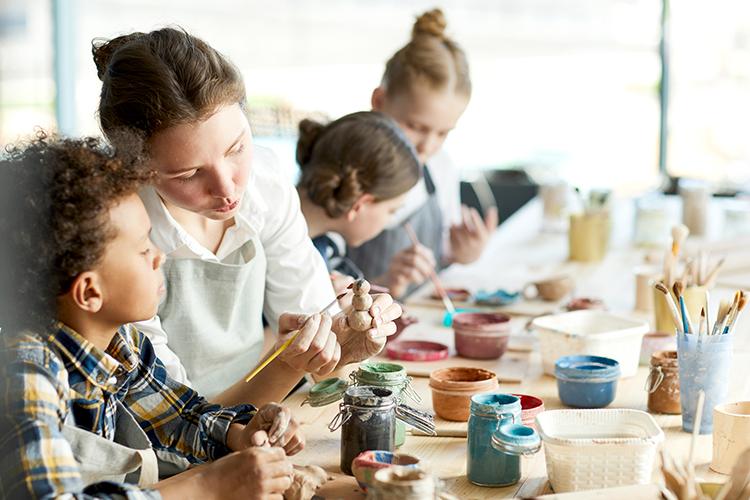 vbs volunteer, women and children making crafts