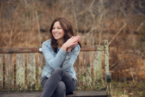 Photo of Kelly Minter sitting on a bench