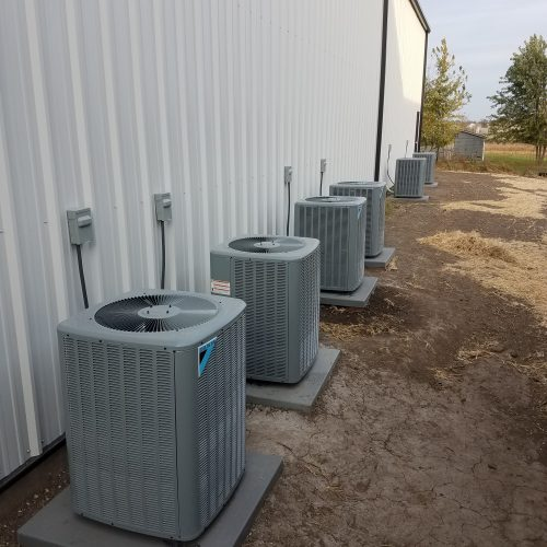 Air conditioning units placed outside of a building