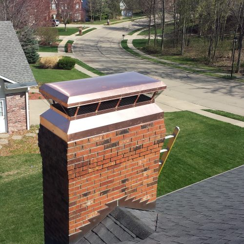 A chimney on top of a home