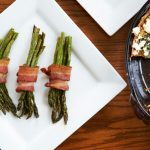 Bacon wrapped asparagus accompanied by quiche topped with feta