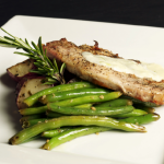 A delicious rosemary chicken accompanied by green beans and herb roasted potatoes
