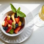 bowl of summer fruit with garnish