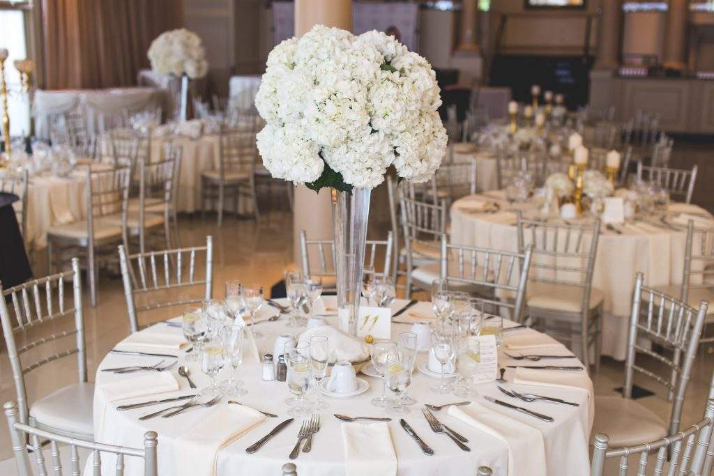 white rose bouquet on wedding table