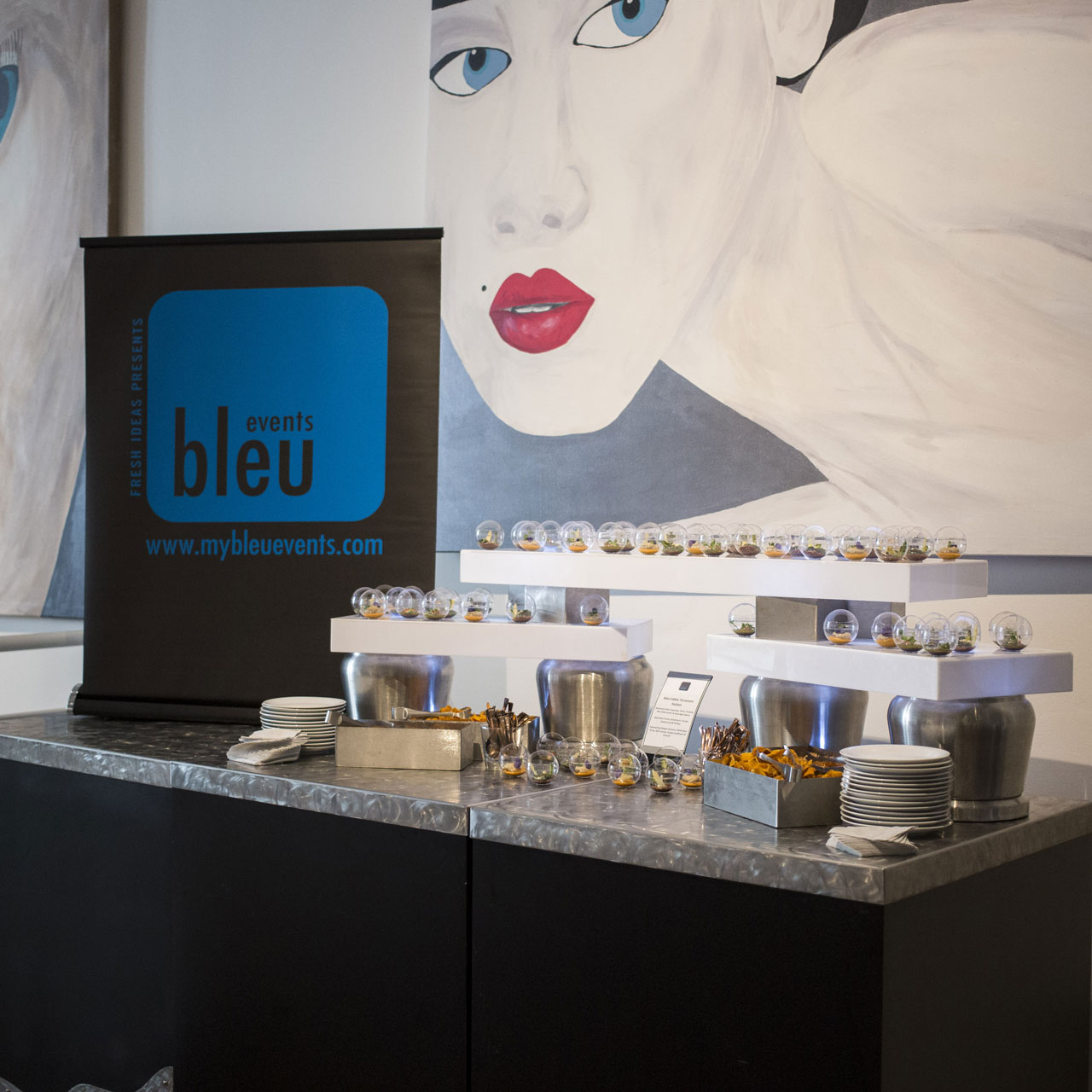 Display of event souvenirs at Randall Art Gallery for an event by Bleu Events