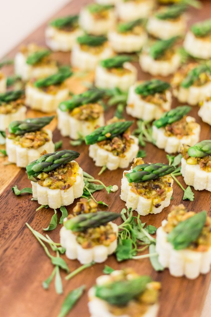 Tray of appetizers with asparagus tips by Bleu Events