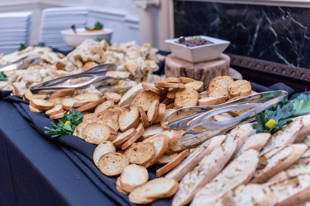 Toasted bread in a catering display at an event by Bleu Events