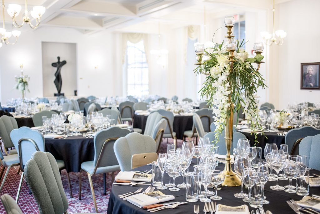 A room full of elegant table setups at an event