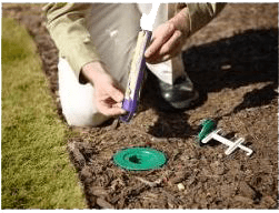 Installing pest control device into ground