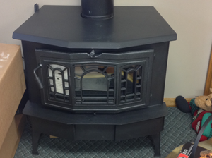 A black gas burning fireplace inside