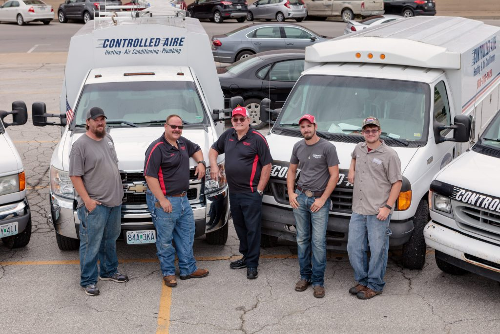 Five of Controlled Aire's HVAC staff posing for a staff photo