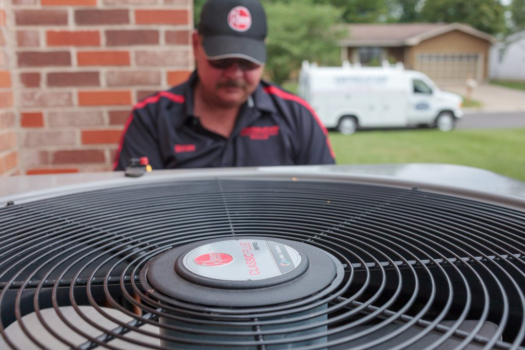 A close-up of an A/C unit being work on by a certified HVAC professional