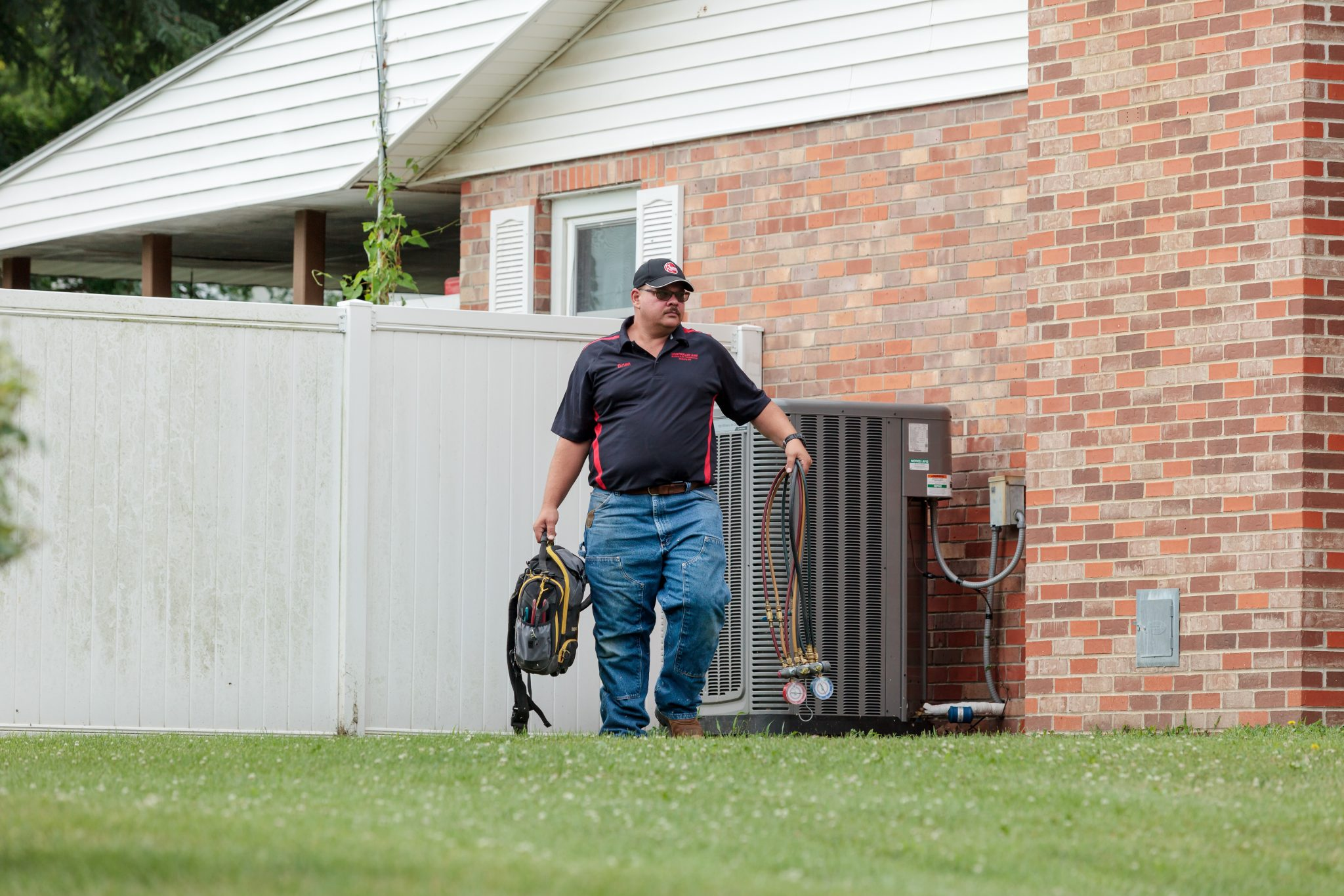 A Controlled Aire employee working on an HVAC project at a customer's house