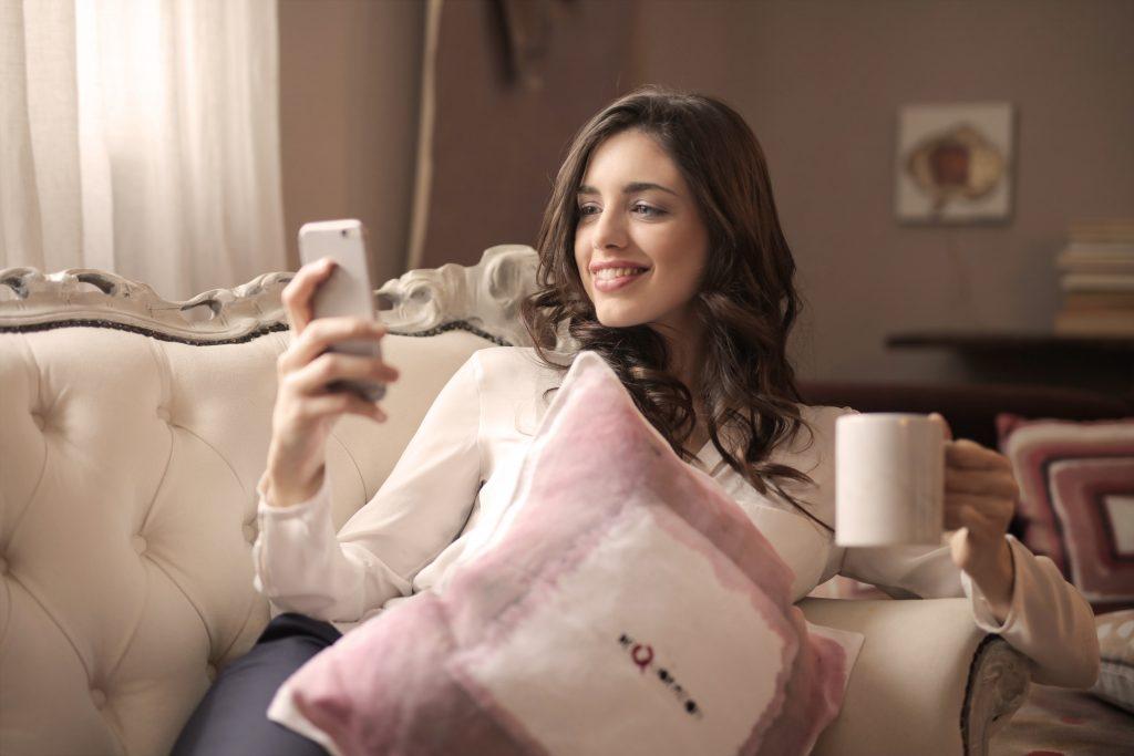 woman lounging on sofa