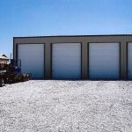 Four white commercial garage doors all in a row